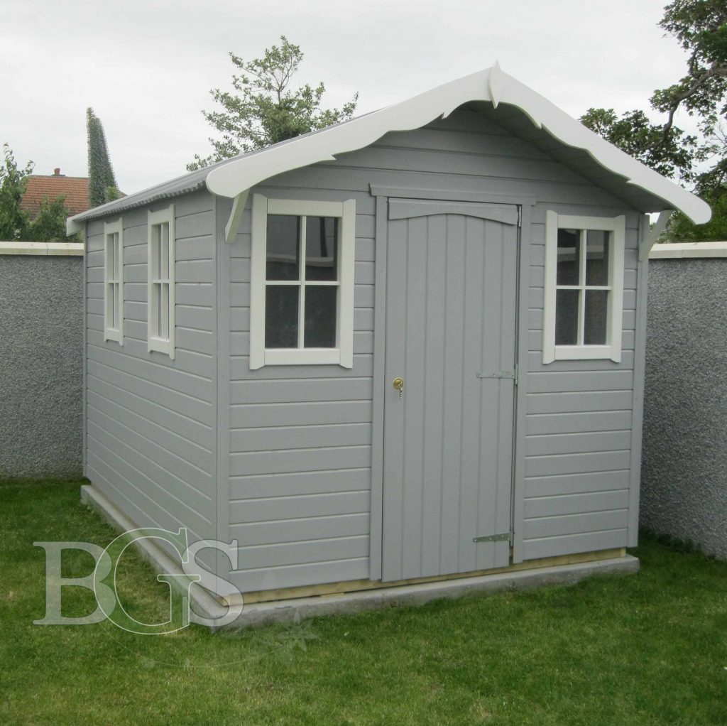 Cabin Style Shed Painted In Techile And Strong White